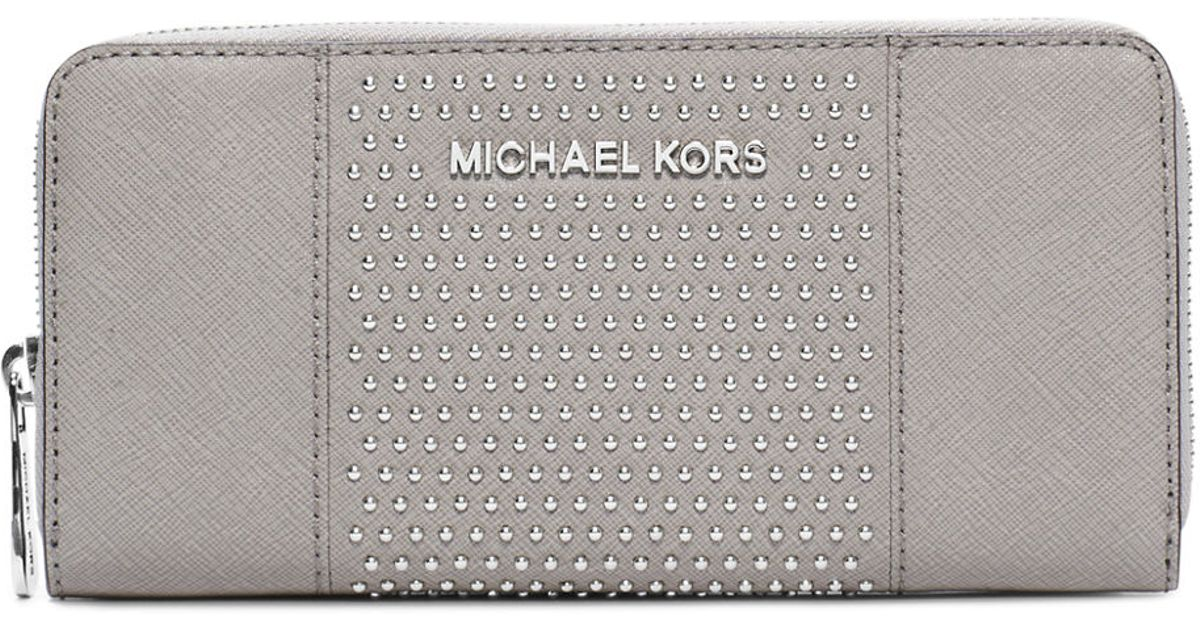 5abe8fe13ffc Michael Michael Kors Leather Microstud Center Stripe Continental Wallet in  White - Lyst