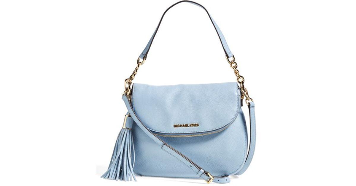 069d24b96f7d2 ... netherlands lyst michael michael kors bedford tassel medium convertible  leather shoulder bag in blue f6ccf d3390