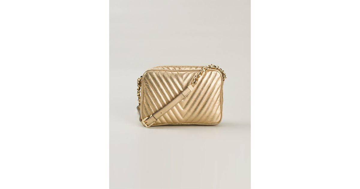 a37d80c96b83 ... sale lyst michael kors metallic leather cross body bag in metallic  d5933 92522