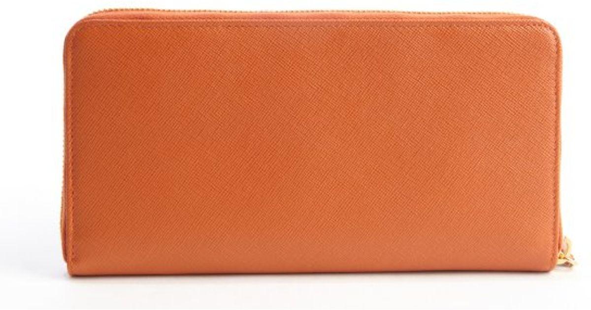 e95142eb4ca8 ... coupon code lyst prada papaya saffiano leather zip continental wallet  in orange f15e0 2f7a3