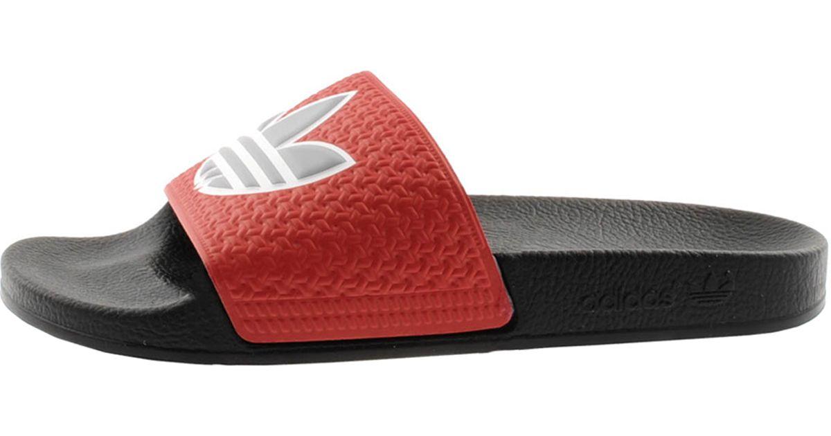 f46e71a37ac8f9 Lyst - adidas Originals Adilette Trefoil Flip Flops in Red for Men