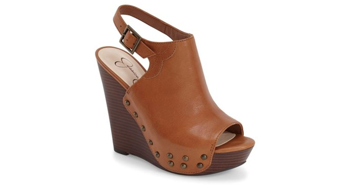 3c5346cd150a Lyst - Jessica Simpson Insana Studded-Leather Wedges in Brown