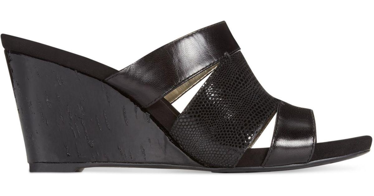 e9fc46fb0757 Lyst - Anne Klein Loopy Wedge Sandals in Black