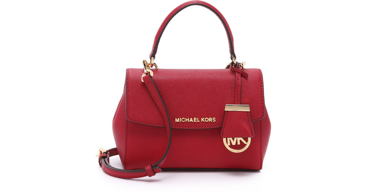0aea98008ff1 ... order lyst michael michael kors ava extra small cross body bag cherry  in red 26fe3 ecba2 ...