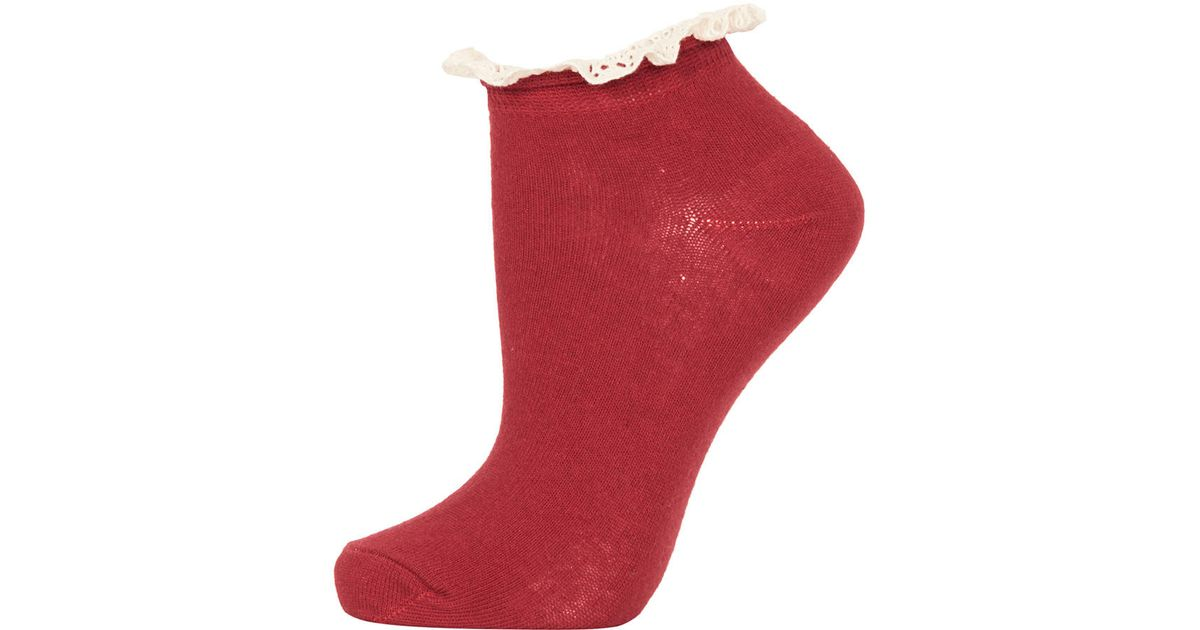 b6ae6d94e2bd Lyst - TOPSHOP Raspberry Lace Trim Trainer Socks in Red