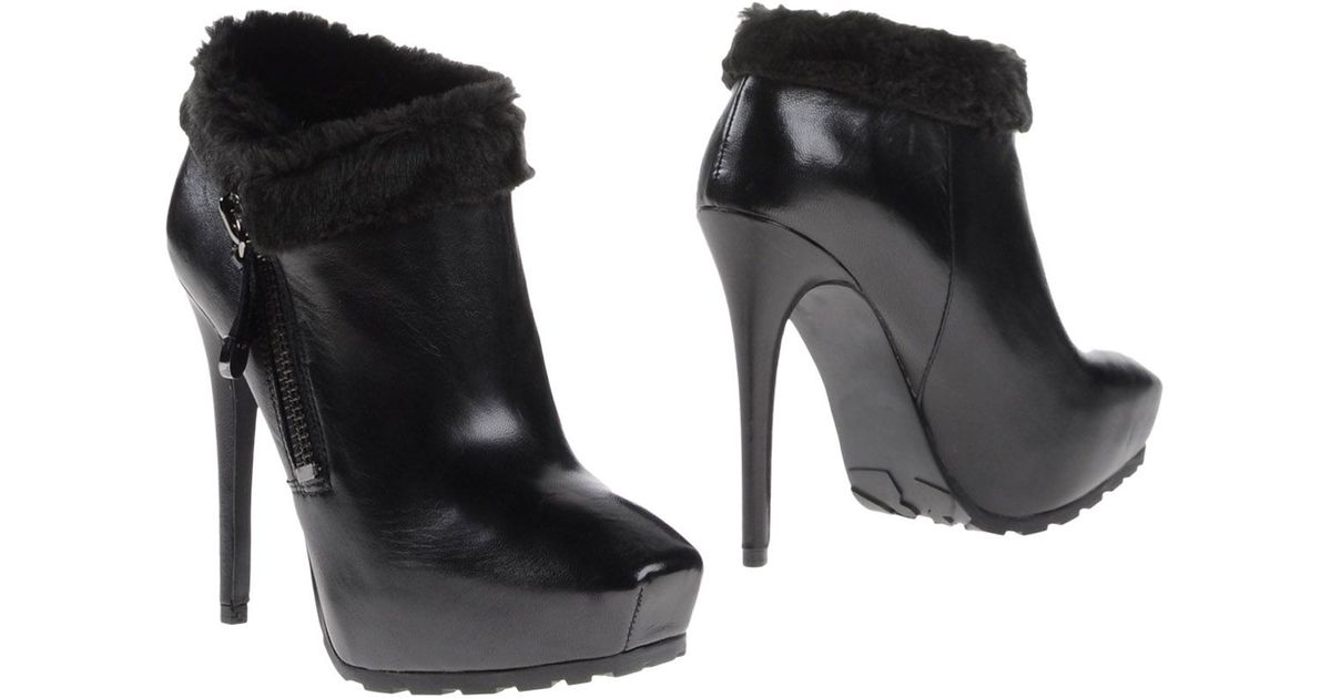guess shoe boots in black lyst