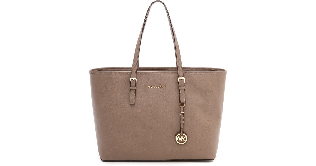 60a6c55fb2d8f6 Lyst - MICHAEL Michael Kors Jet Set Travel Multifunction Tote in Natural