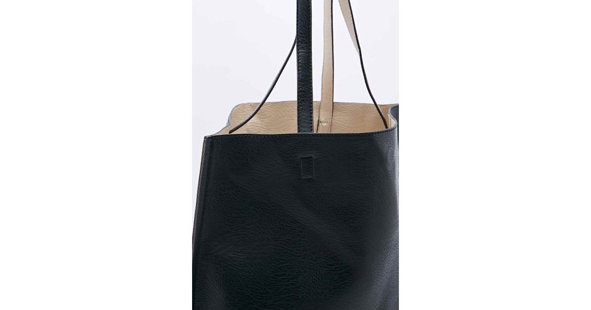 f94acf9b5ffa1 Urban Outfitters Reversible Vegan Leather Oversized Tote Bag in Black - Lyst