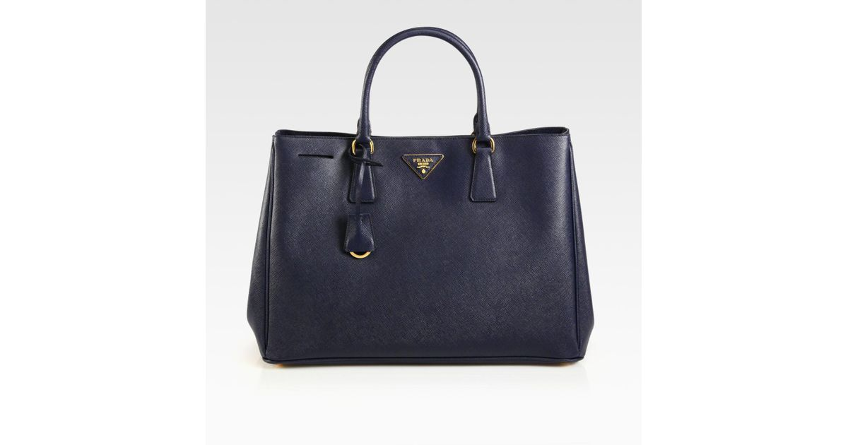 fb81effc4382 Prada Saffiano Lux Tote Bag in Black - Lyst