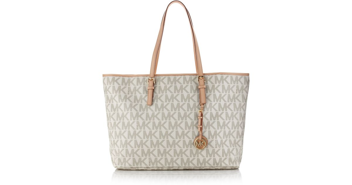 5653dcff34a3 Lyst - MICHAEL Michael Kors Jet Set Logo Laptop Travel Tote in Natural