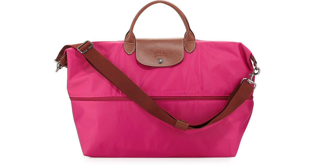 920e65e25744 Lyst - Longchamp Le Pliage Expandable Travel Bag in Pink