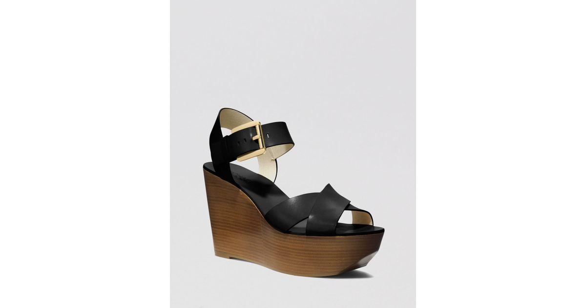 22de232511e7 Lyst - MICHAEL Michael Kors Open Toe Platform Wedge Sandals Peggy in Black
