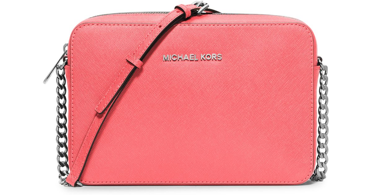 ed5583db96b5 MICHAEL Michael Kors Jet Set Travel Large Saffiano Leather Crossbody Bag in  Pink - Lyst