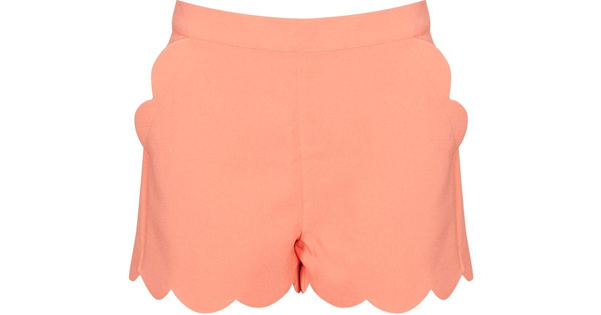 0253a248a3d36 TOPSHOP Apricot Scallop Hem Shorts in Orange - Lyst