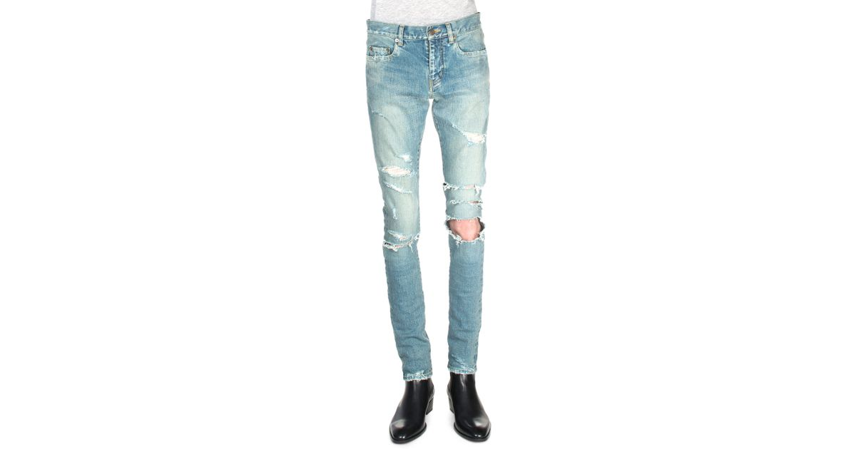 78c22854 Saint Laurent Trashed Ripped-knee Denim Jeans in Blue - Lyst