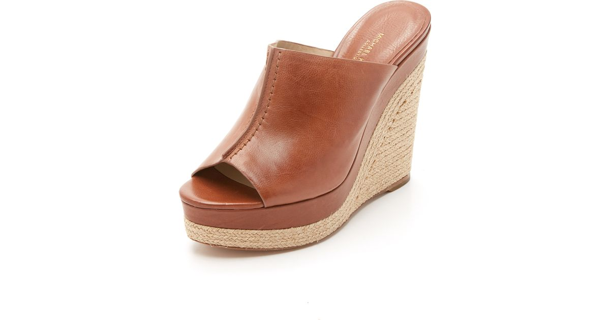 e0e1c7acfb3 Lyst - Michael Kors Charlize Wedge Mules in Brown