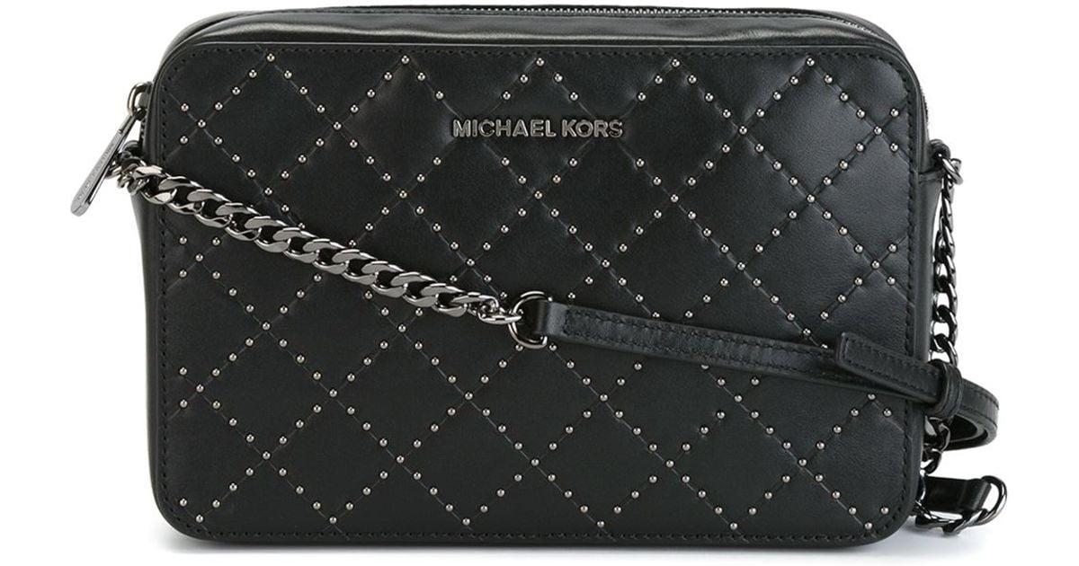 7edb4fbea692 Lyst - MICHAEL Michael Kors Studded Cross-body Bag in Black
