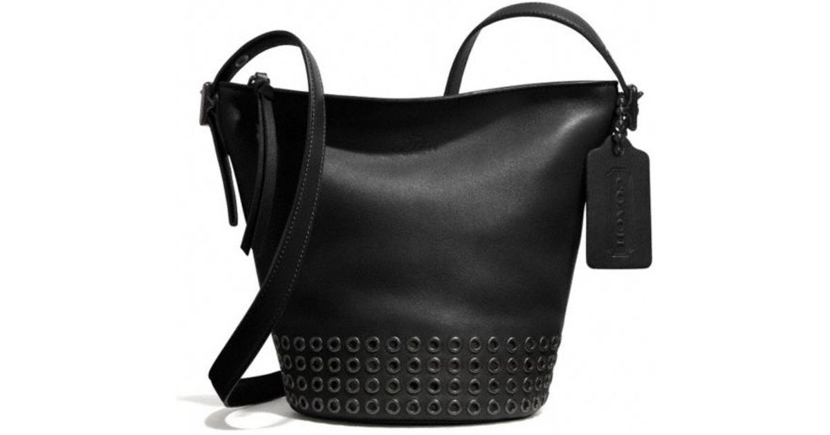 90edbea51e06 ... real lyst coach bleecker grommets mini duffle bag in leather in black  8b68f 54fd2