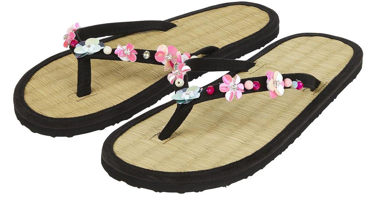 355f4c726b05 Accessorize Embellished 3d Flower Seagrass Flip Flops in Black - Lyst