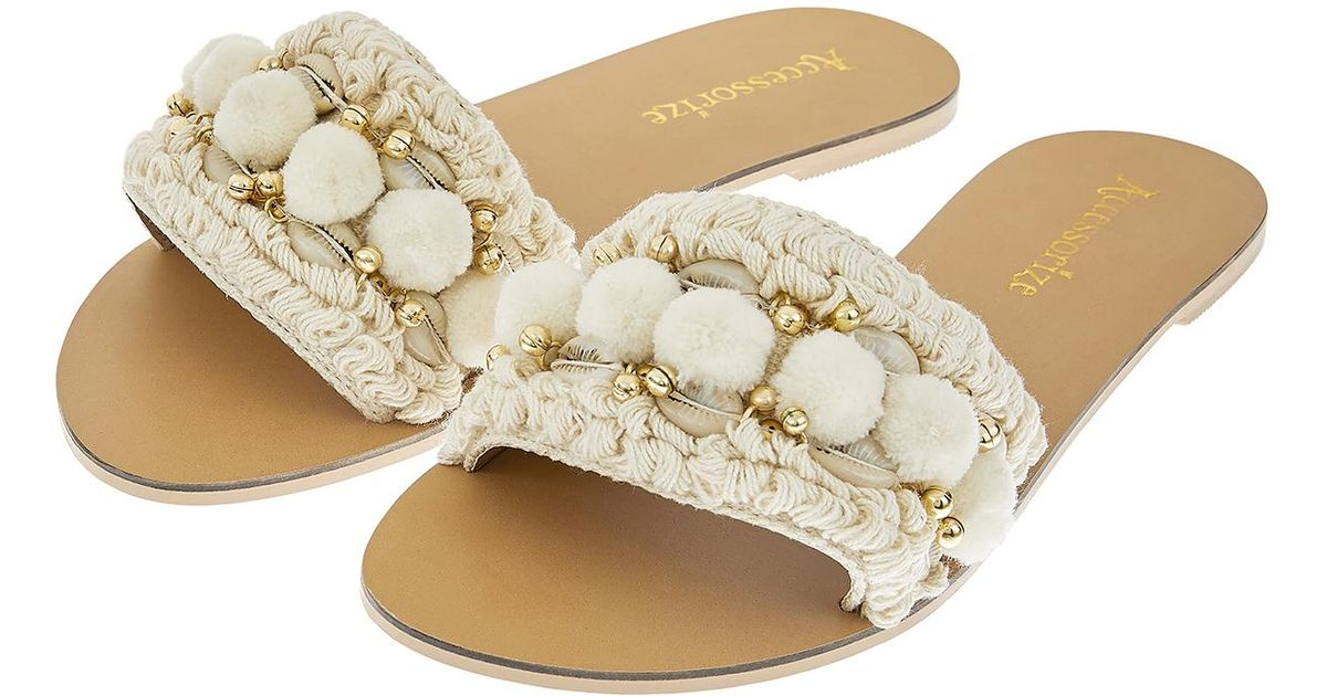 e4e6e5e441b4ca Accessorize Penelope Pom Pom Slider Sandals in Natural - Lyst