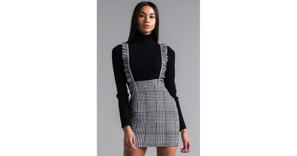 2d4e2ff9908 Lyst - AKIRA Great Scott Houndstooth Overall Mini Dress in Black