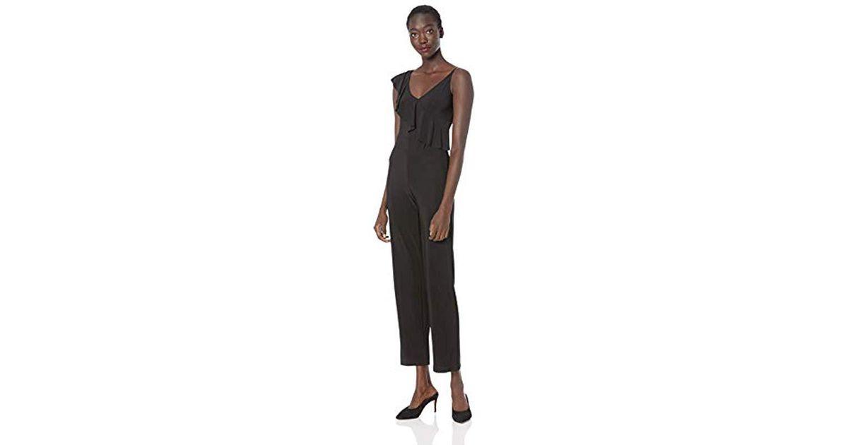 bdec47fb180 Lyst - Bebe Asymmetrical Ruffle Jumpsuit in Black