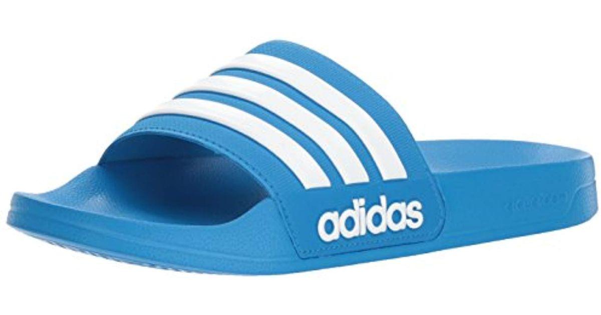 02fd6bc72ed18d Lyst - adidas Originals Adilette Shower Slide Sandal in Blue for Men