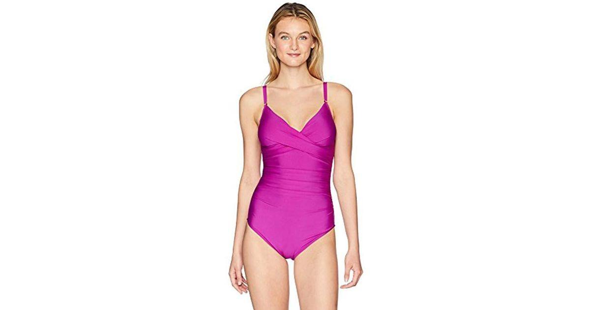 34b5954af7 Lyst - Calvin Klein Solid Twist Over Shoulder One Piece Swimsuit Tummy  Control in Purple