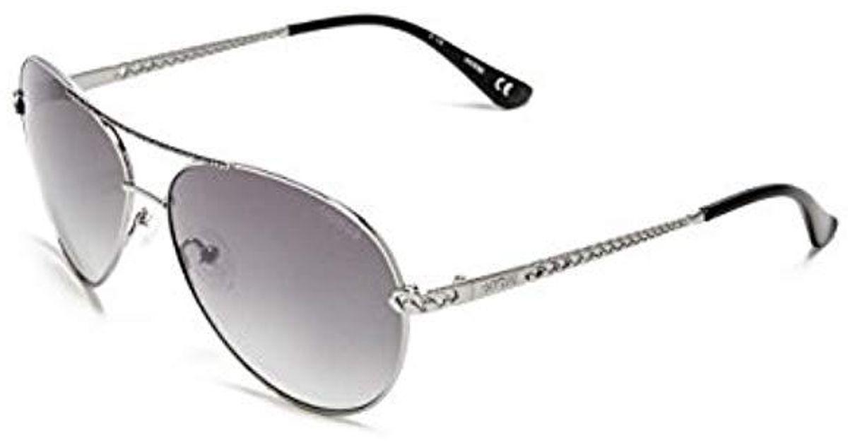 c9e3ca783a8 Lyst - Guess Catherine Rhinestone Aviator Sunglasses - Save  29.268292682926827%