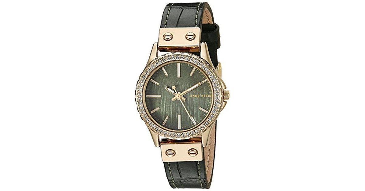 9bec13729 Anne Klein Ak/3250gmgn Swarovski Crystal Accented Gold-tone And Green  Leather Strap Watch - Lyst