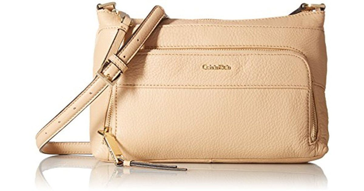 c099b626d8c Calvin Klein Top Zip Pebble Leather Crossbody in Natural - Save 50% - Lyst