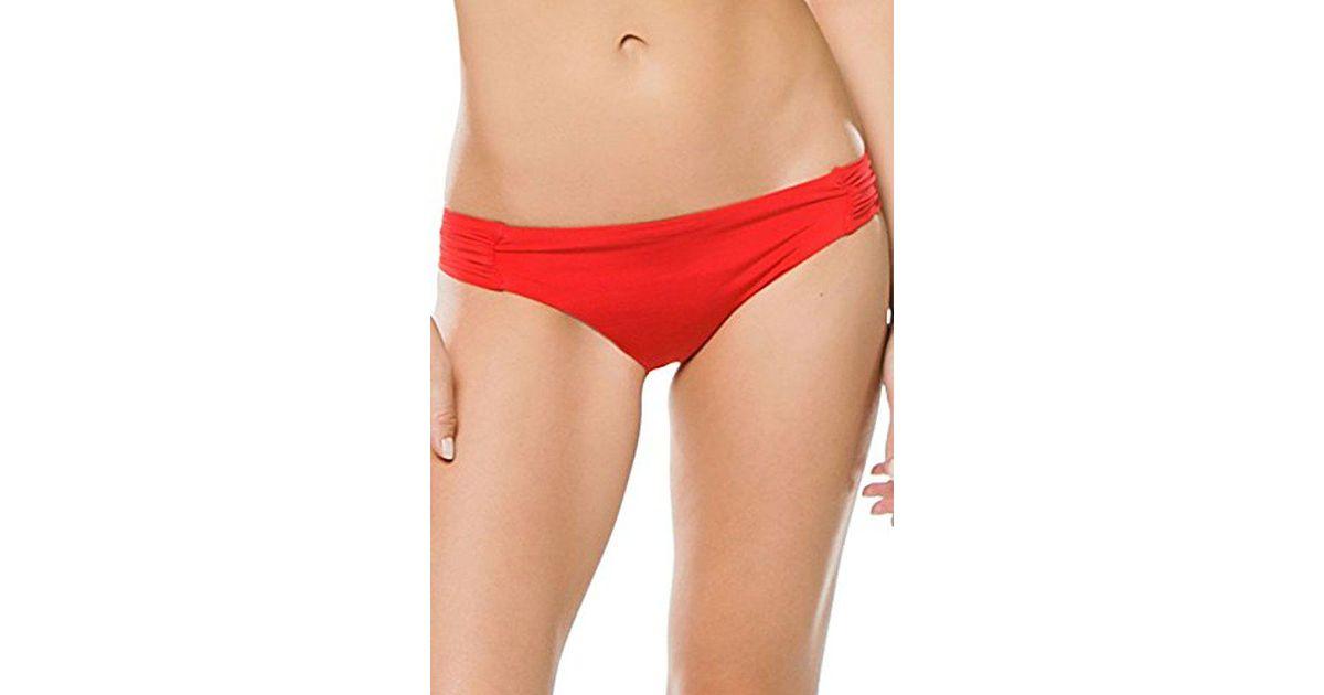 5d130ec5ac284 Lyst - Trina Turk Indo Solids Shirred Side Hipster Bikini Bottom in Red