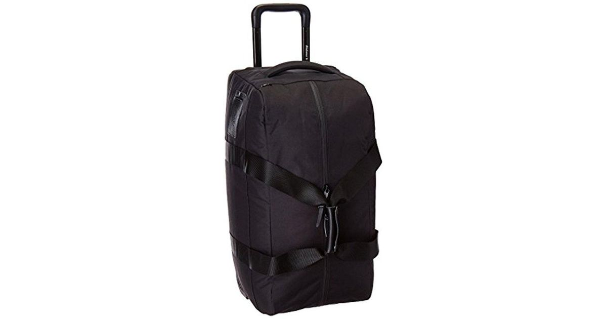 Lyst - Herschel Supply Co. Wheelie Outfitter Travel Duffle in Black for Men 95954bfc09