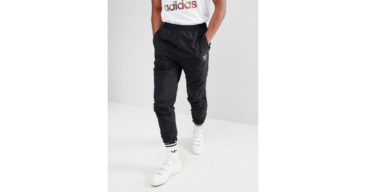 online store a8d42 79819 adidas Originals X Pharrell Williams Hu Hiking Joggers In Black Cy7868 in  Black for Men - Lyst