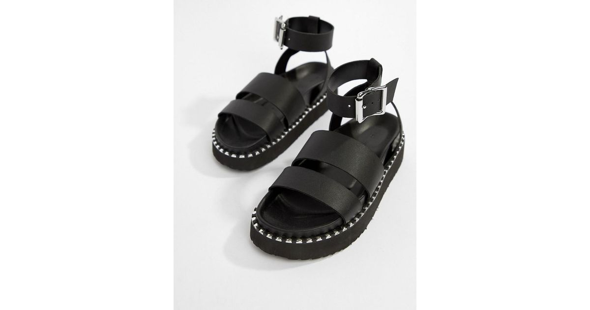 cf8f7bec4e ASOS Feebs Leather Chunky Flat Sandals in Black - Lyst