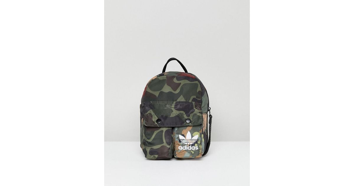 c06dd8e574e ... greece adidas originals x pharrell williams hu camo mini backpack lyst  65aa0 a6eef