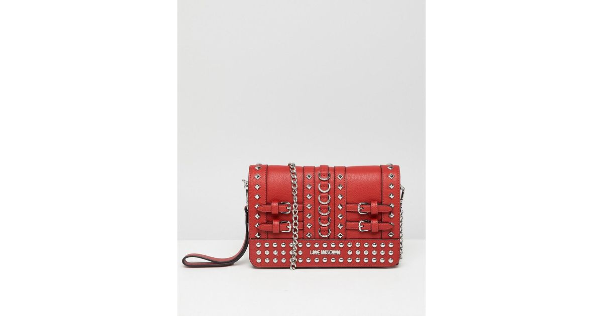 1adb7a60b9 Love Moschino Stud Detail Clutch With Chain Strap in Red - Lyst
