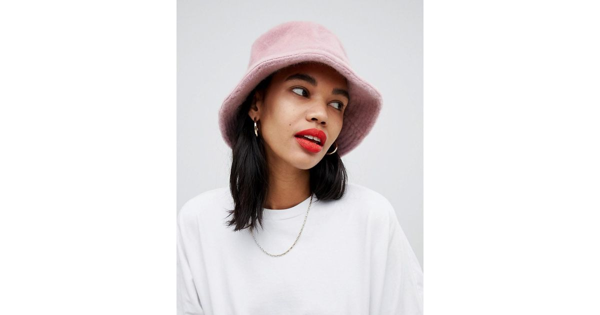 707b7d46e43 Lyst - ASOS Fluffy Bucket Hat in Pink