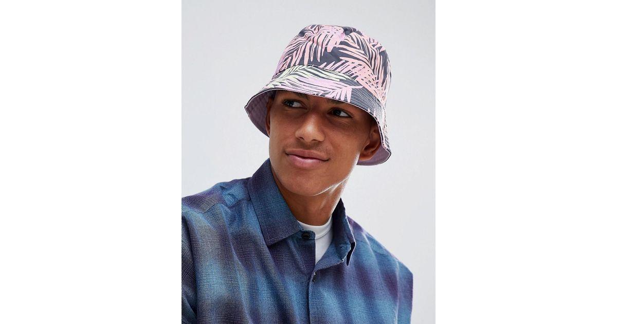 5ea84274f37f0 ASOS Festival Reversible Bucket Hat In Black With Bright Leaf Design for  Men - Lyst
