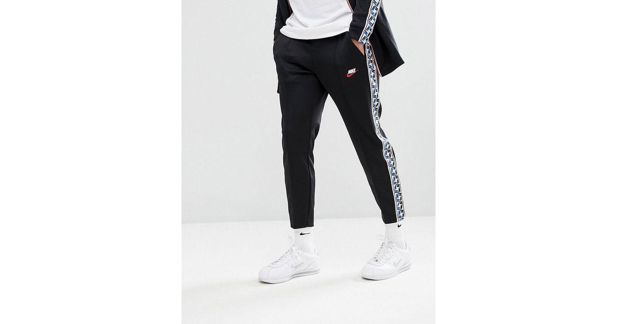 829551fb04695 Nike Joggers With Taped Side Stripe In Regular Fit In Black Aj2297-010 in  Black for Men - Lyst