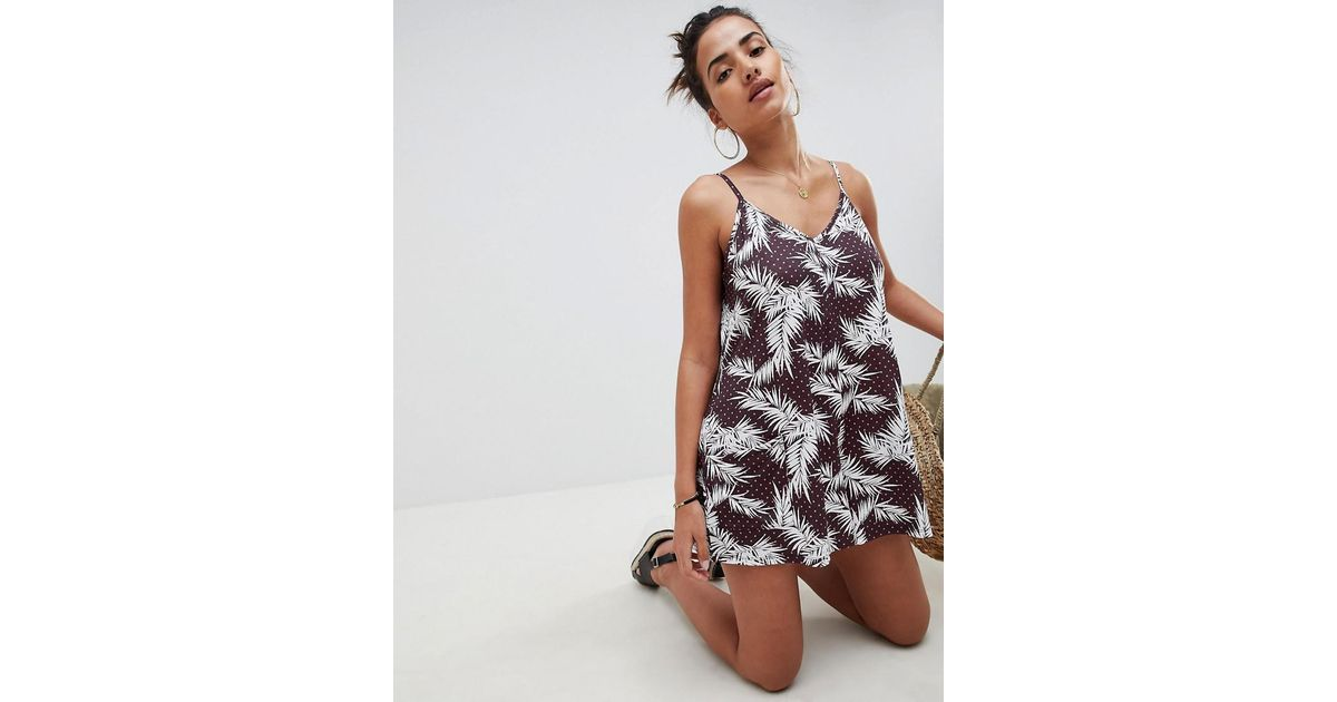 47ef56ae1772 ASOS Minimal Jersey Playsuit With Pockets In Leaf And Spot Print - Lyst