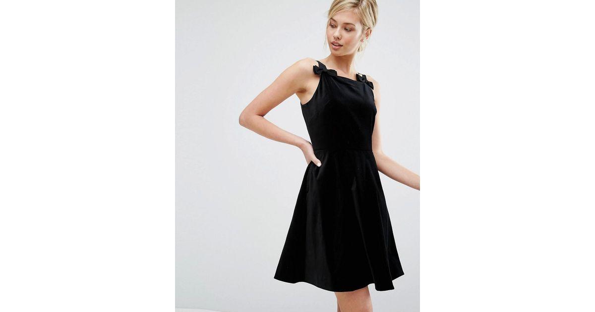 f9baea1469a Lyst - Ted Baker Velvet Skater Dress With Bow Detail in Black