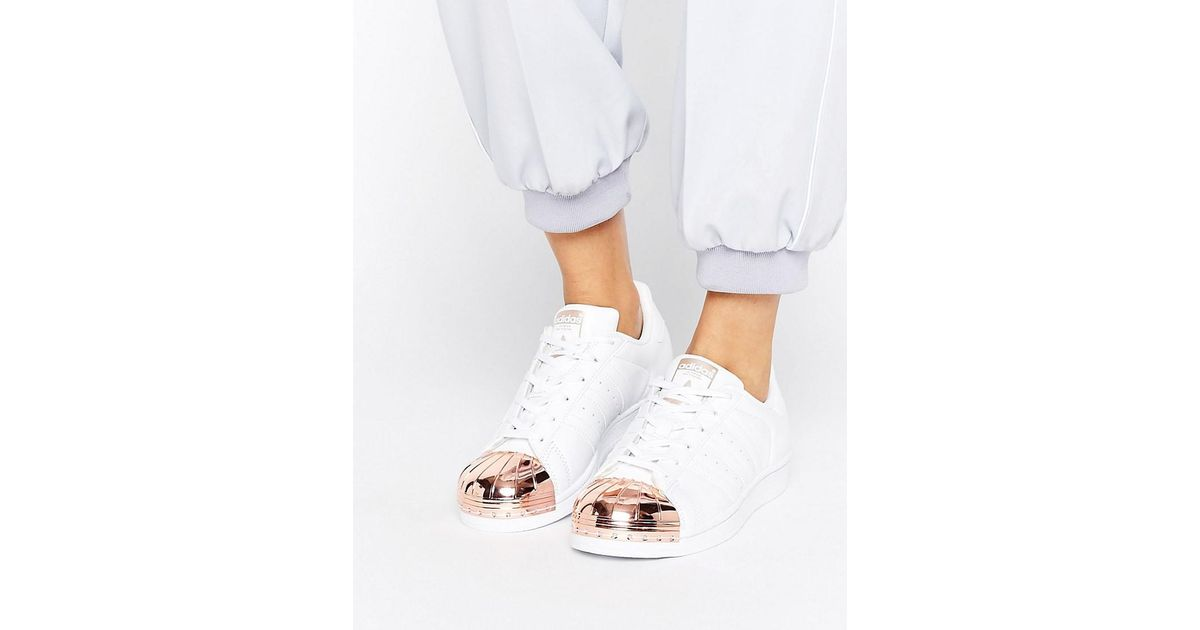 Lyst - adidas Originals Originals White Superstar Sneakers With Rose Gold  Metal Toe Cap in White 4d9586f7f6b