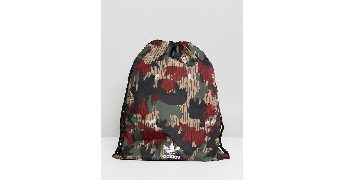 617b275148 Lyst - adidas Originals Originals X Pharrell Williams Hu Camo Drawstring Bag