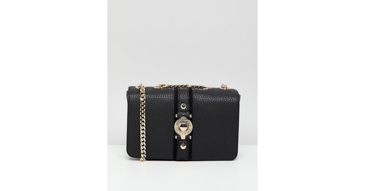 91b8e5cee1 Versace Jeans Embossed Logo Crossbody Bag With Studding Detail in Black -  Lyst