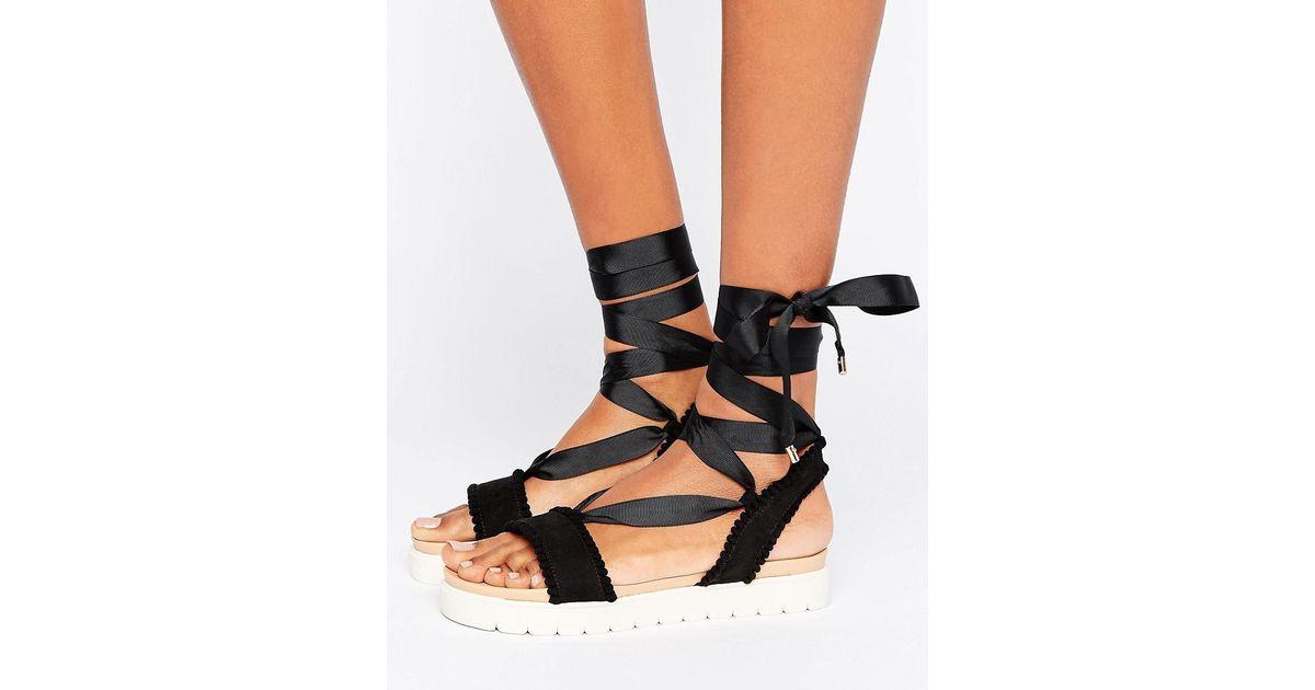 2de418fbcc1e03 Miss Kg Dakota Pom Tie Up Flat Sandals In Black Lyst