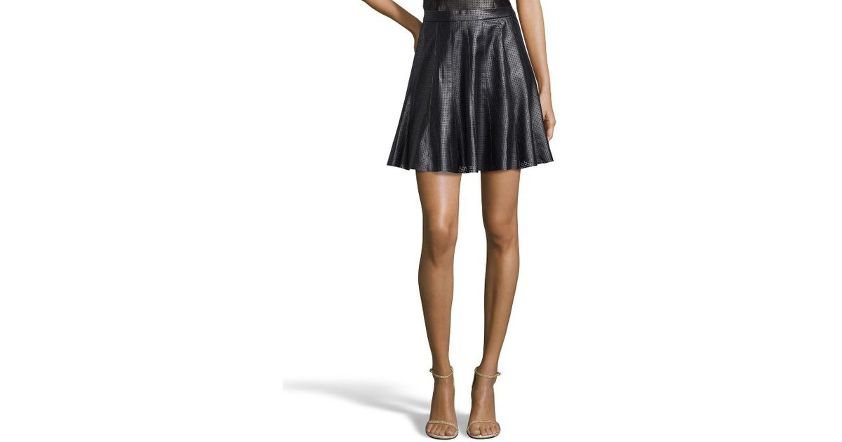 godfrey black faux leather perforated flared skirt in