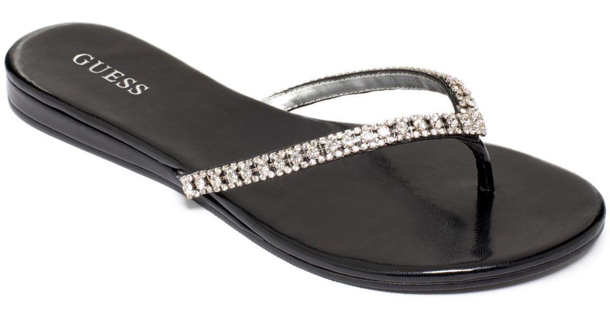 d3fe1ff24c954 Lyst - Guess Jasper Embellished Flip Flops in Metallic