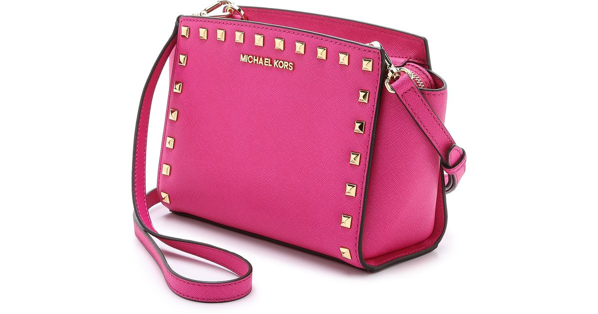 0612eec10528 ... discount michael michael kors selma stud messenger bag optic white in  pink lyst 3dcd8 825cd