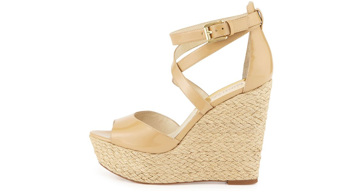 93be305c25d Lyst - MICHAEL Michael Kors Gabriella Patent-Leather Wedge Sandals in  Natural